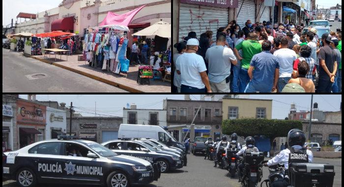 Comerciantes reabren por desesperación y enfrentan a inspectores; en Tu Plaza sacan puestos a la calle